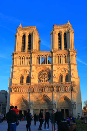 Notre Dame Cathedral in Paris and visiting tourists , France