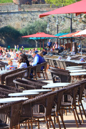 Tourists sitting on the terrace of a french cafe in Collioure, eastern pyrenean in the southern of France