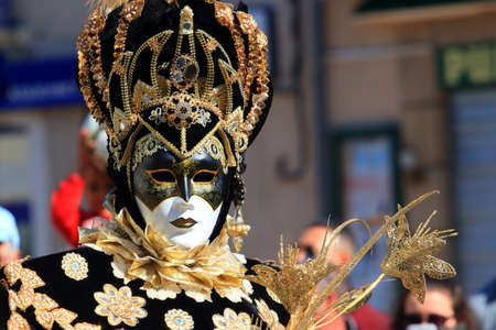 man with a Venetian mask at the carnival of Limoux in the Aude, Occitanie in the south of France