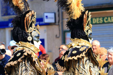 men with a Venetian mask at the carnival of Limoux in the Aude, Occitanie in the south of France Redactioneel