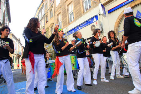 Brazilian women playing tambourine at Limoux Carnival in Aude, Occitanie in the southern of the France
