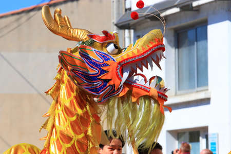 dragon at asia parade at the Limoux carnival in Aude, Occitanie in the south of France