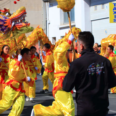 Asian parade with a dragon at the Limoux carnival in Aude, Occitanie in the south of France