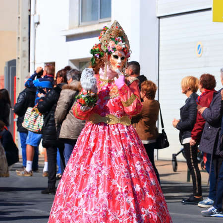 woman with a Venetian mask at the carnival of Limoux in the Aude