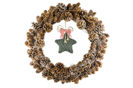 Vintage Christmas wreath with red ribbon bow on stars photo