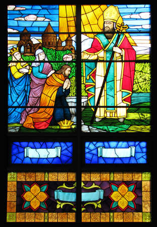 swaddling: Stained glass window in church  Stock Photo