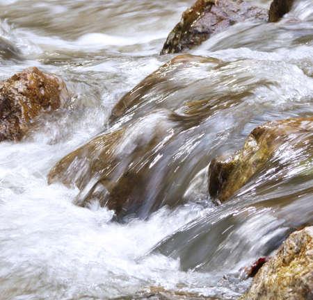 Water flowing over stones photo
