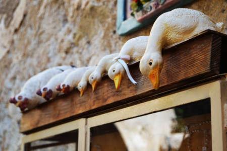 Row of ceramic ducks Stock Photo