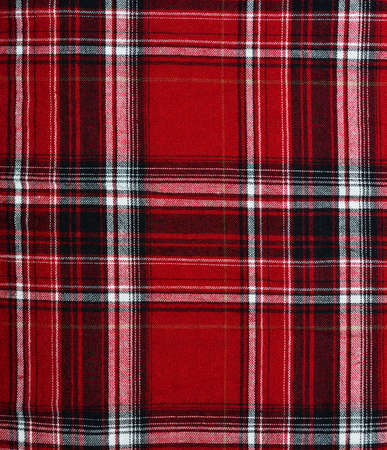 Texture of red-black checkered fabric pattern background photo