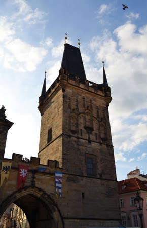 Bridge tower at one end of Charles bridge on Vltava river photo