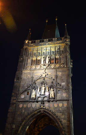 Charles bridge tower in Prague at night Stock Photo