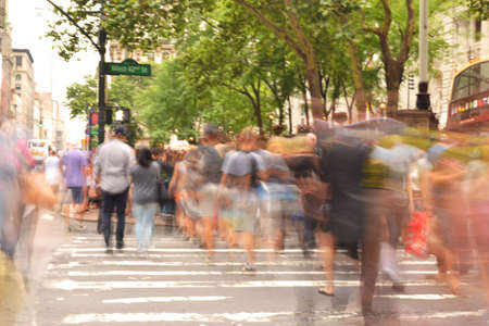 People crossing busy street Stock Photo