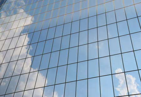mirrored: Cloudy sky reflected in the windows of a skyscraper
