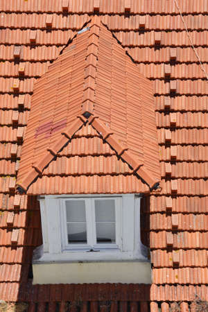 Framed window on the tile roof