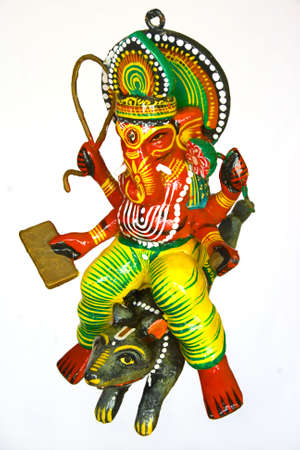 colrful: Lord Ganesh the hindu god riding on a mouse