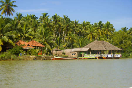 Kerala backwaters at trivandrum lake with a houseboat, Gods own country, india photo