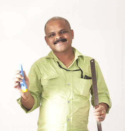 journeyman: smiling indian journeyman with tools of his trade on a light background Stock Photo