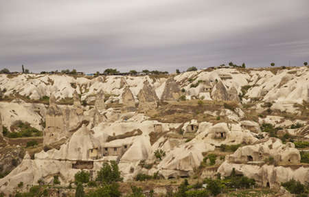 Panoramic view of Goreme, Cappadocia, Turkey under a layer of clouds. Landscape of rock formation and weathered limestone chimneys Stock Photo - 10079385
