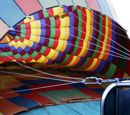 inflating: interior of a multi-colored hot air balloon whilst inflating,
