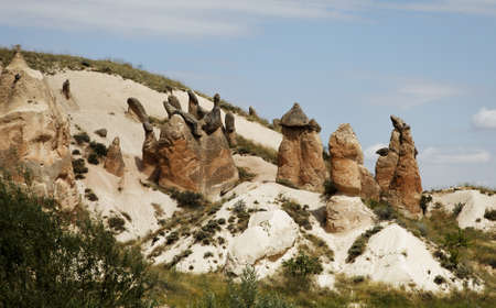 strange sandtsone formation of a crown and chimneys. Landscape, copy space crop are, blue cloudy skies,rugged terrian with bushes and greenery. Stock Photo - 10143782