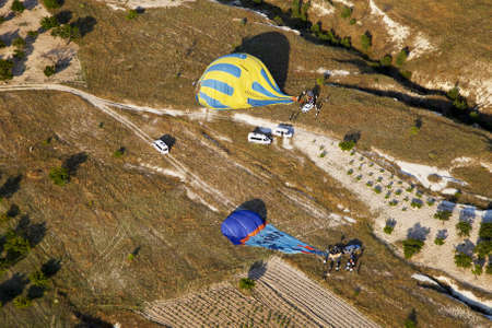 landed: June 2011 aerial view of landed hot air balloons being packed away, Cappadocia, Turkey, Horizontal, copy space
