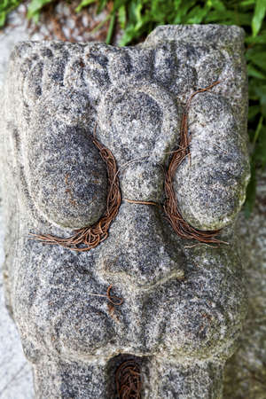 portrait of a Hindu worshipping idol forming a garden feature in Kerala, India, close crop