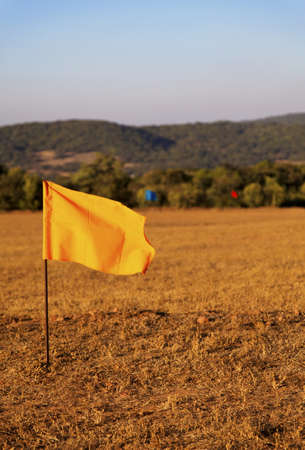 metre: golf drive range in Mahabhaleshwar India, 100 metre colored flag markers, portrait, crop margin and empty negative areas Stock Photo