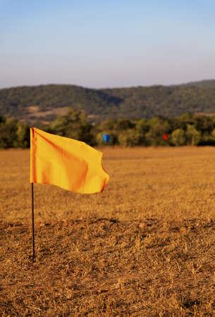 crop margin: golf drive range in Mahabhaleshwar India, 100 metre colored flag markers, portrait, crop margin and empty negative areas Stock Photo