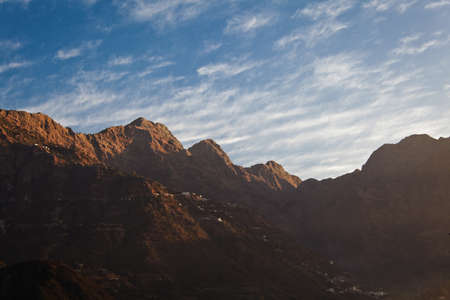 devi: From Katra in Jammu Kashmir, side of the Trikuta peaks defining the 14 kilometer footpath and pony trail up the side of the mountain to Vaishno Devi Temple, a shrine and and popular Hindu pilgrimage Stock Photo