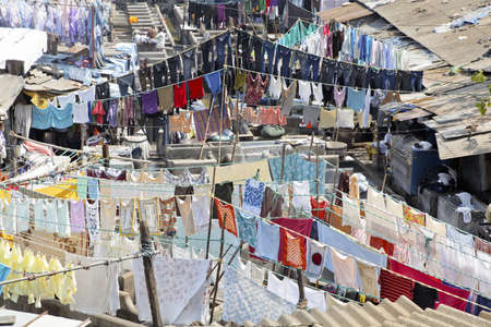 Mumbai, Dhobhi ghat, community at work and clothes drying on washing lines at commercial laundry