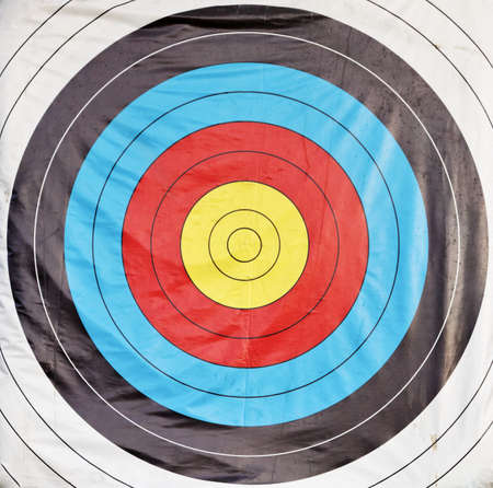square format close crop of bulls eye ring archery target board, white, black, blue, red, yellow