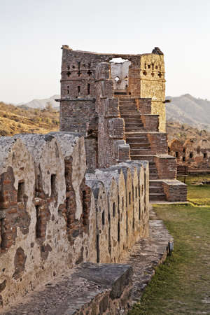 Kumbhalgarth Fort, Rajasthan, India, Landscape of one of the delapidated towers of the 15th century built fort showing part oif the wall that streches 34kms and the only other man made structure aprt from wall of China that is visible from space