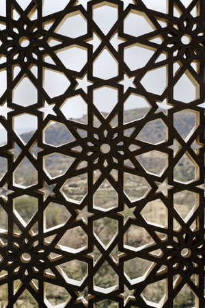 architectural detailing: Indigenouse concrete craftwork of Rajasthan India on a window opening, grid design allows air and light circulation but prevents the nesting of birds