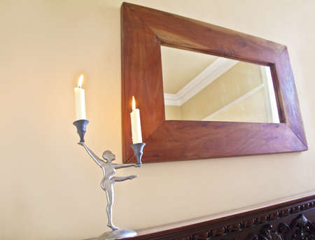 Ballerina Candelabra on the matlepiece with oak framed mirrorand chimney breast Stock Photo - 13212478