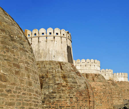 Exterior walls of Kumbhalghar Fort built in the 9th century and of Indian historical significance, turrets and public footpath and curved features to towers Editorial