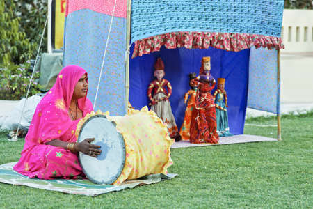 Man and woman team of puppeteers performing fokelore stories of historical charactors generally involving the exploits of local heros and maharajahs