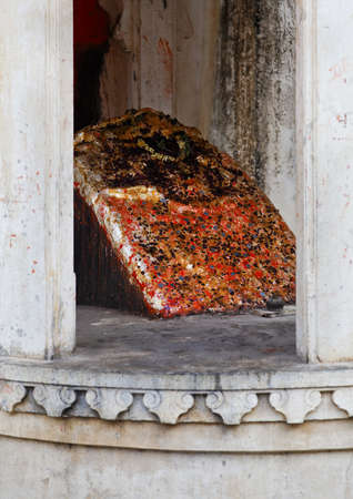 negative area: Vertical shot of a shivling for hindu worship inside the royal quarters at Kumbhalghar Fort Editorial