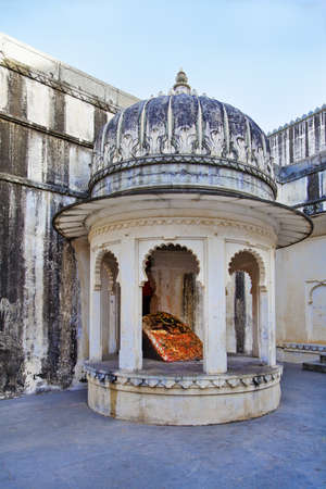 shivling: Vertical shot of a place of worship for hindus set in a corner of the royal living quarters of Kumbhalgarth Fort,  shivling in a domed building with pillars representing architecture from the 9th Century AD Editorial