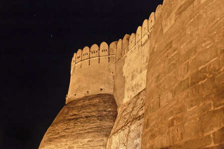 negative area: Landsacpe of the exterior near the main gate and bastions of Kumbhalghar Fort at night Editorial