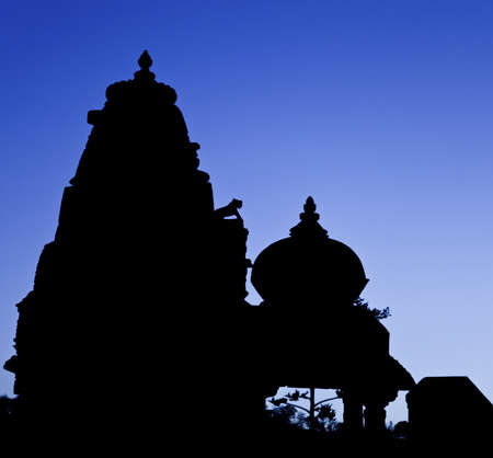 Rajasthan, India, silhouette of Jain and Hindu temples side by side as the night falls Stock Photo - 13529392