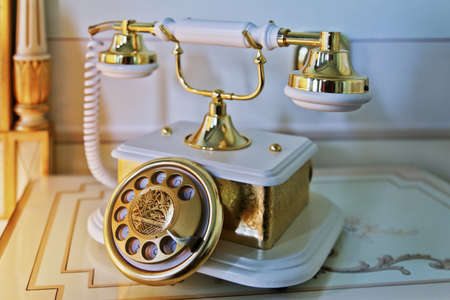 Horizontal shot of an old base and hand piece telephone in a luxurious room setting