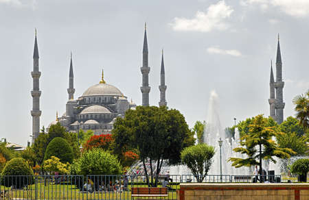 Landscape of the the Blue Mosque Istanbul, its fountains, gardens and general public picnicing in the grounds