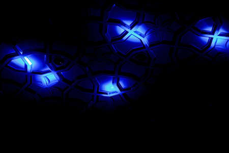 crop margins: Generic shot of blue spot lights falling on a patterned surface creating shapes, angles, lines and form