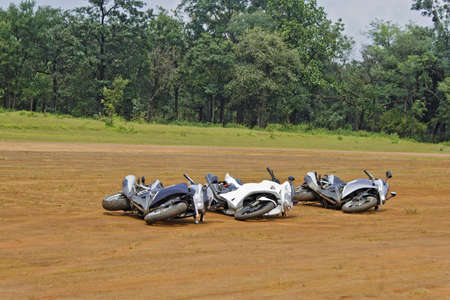 Three generic motorbikes dropped on their side  Concept, play dead they might go away  Location of shot India Stock Photo - 15806797