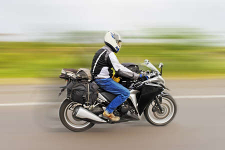 Touring motorcyclist speeding to get home from recent tour  Shot location, Maharashtra, India