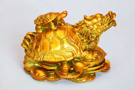 studio shot of ornamental feng shui mother tortoise and offspring on her back, rendered photograph photo