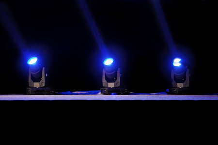 location shot: Horizontal capture of blue spot lights on a theater stage pre-curtain raise  Location of shot Grand Hyatt, Goa, India