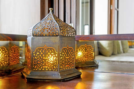 Interesting table lamp on a corner unit shaped like an oriental lantern with electric tungsten bulb  Generic image and interior detail, shot location , Goa, India Stock Photo - 15914135