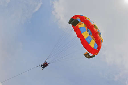 Generic landscape of a pair of female paragliders photo