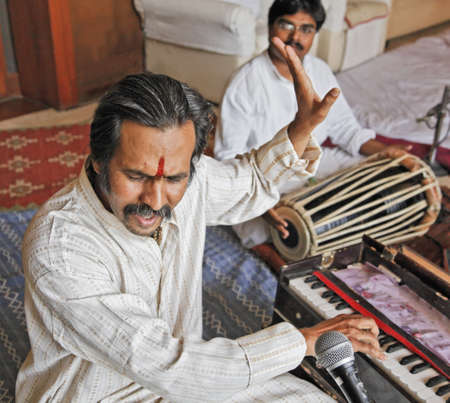 private party: Bombay singer Manoj Desai on harmonium and Hanumant Ghadge on tablas accompaniment in full rehearsal at a private party